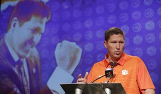 Clemson head coach Brad Brownell answers a question during the Atlantic Coast Conference men's NCAA college basketball media day in Charlotte, N.C., Wednesday, Oct. 25, 2017. (AP Photo/Chuck Burton)