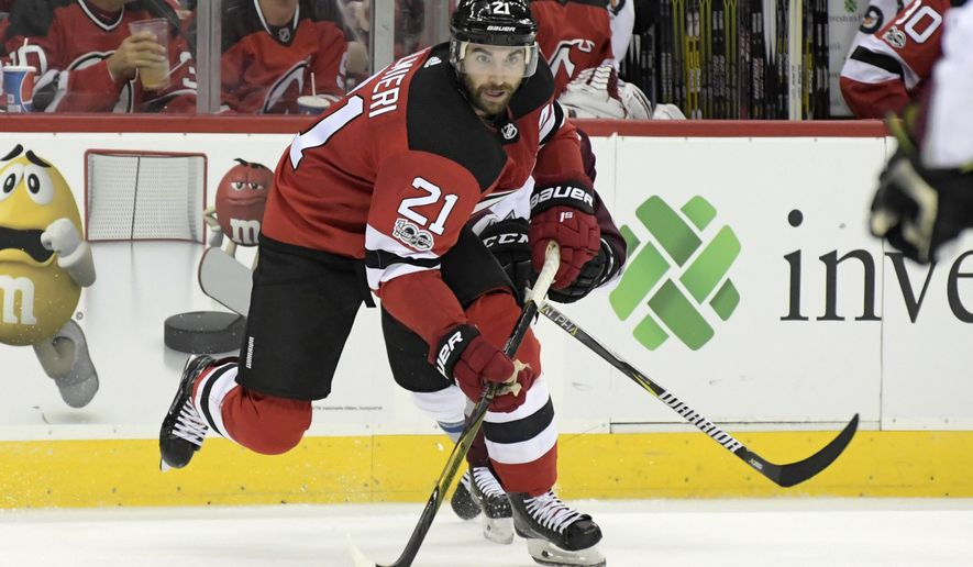 In this Oct. 7, 2017, photo, New Jersey Devils right wing Kyle Palmieri (21) passes the puck during the second period of an NHL hockey game against the Colorado Avalanche in Newark, N.J. After finishing at the bottom of the Eastern Conference last season, the Devils have been among the NHL's surprise teams. (AP Photo/Bill Kostroun)