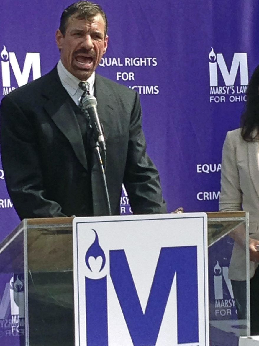 FILE – In this June 22, 2017, file photo, Henry Nicholas, for whose murdered younger sister Marsy's Law is named, speaks outside the Ohio Secretary of State's office in Columbus, Ohio. Nicholas is the billionaire technology executive from California behind one of the two ballot issues in Ohio's Tuesday, Nov. 7, 2017, general election, the crime victims' rights measure labeled Issue 1. (AP Photo/Julie Carr Smyth, File)