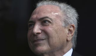 Brazil's President Michel Temer attends the Aviator Day ceremony at the Brasilia Air Base, Monday, Oct. 23, 2017. Aviator Day commemorates Brazil's first official flight and celebrates the Brazilian Air Force. (AP Photo/Eraldo Peres)