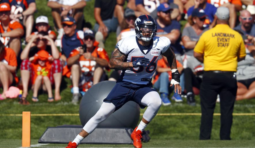 FILE - In this July 28, 2017, file photo, Denver Broncos outside linebacker Shane Ray (56) takes part in drills during NFL football training camp in Englewood, Colo.  The Denver Broncos outside linebacker returns to action Monday night at Kansas City after missing just six games with a broken left wrist that required surgery in late July. (AP Photo/David Zalubowski, File)