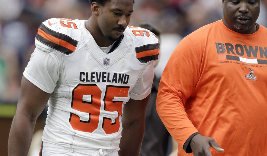 FILE - In this Oct. 15, 2017, file photo, Cleveland Browns defensive end Myles Garrett (95) walks off the field at the half during an NFL football game against the Houston Texans in Houston. Garrett has been placed in concussion protocol. The top pick in this year's NFL draft reported to the team's facility on Wednesday with concussion-like symptoms. It's unlikely he'll play in Sunday's game at London. Garrett has four sacks in three games. He missed the season's first four games with a sprained ankle. (AP Photo/Eric Gay, File)