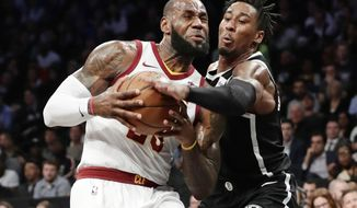 Brooklyn Nets' Rondae Hollis-Jefferson (24) defends Cleveland Cavaliers' LeBron James (23) during the first half of an NBA basketball game Wednesday, Oct. 25, 2017, in New York. (AP Photo/Frank Franklin II)