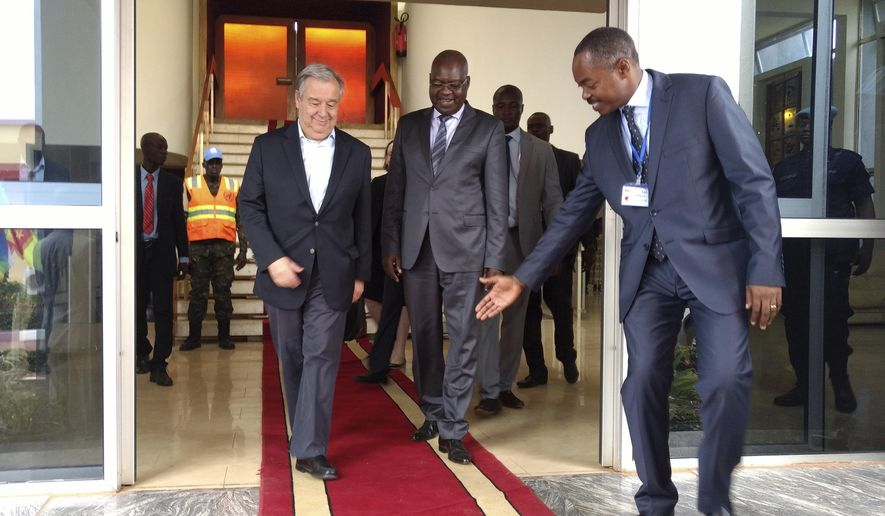 U.N. Secretary-General Antonio Guterres, left, is welcomed by Central African Republic Prime Minister, Simplice Sarandji, centre, upon arrival at the airport in Bangui, Central African Republic, Tuesday, Oct. 24, 2017.   Guterres paid tribute Tuesday to the thousands of U.N. peacekeepers in Central African Republic, the site of one of the U.N.'s most dangerous missions and the most sexual misconduct allegations against peacekeepers and U.N. personnel last year. (AP Photo/Joel Kouam)
