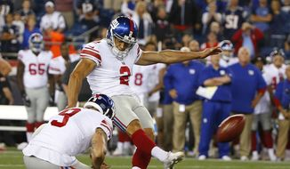 FILE - In this Thursday, Aug. 31, 2017 file photo, New York Giants kicker Mike Nugent kicks a field goal against the New England Patriots during the second half of an NFL preseason football game in Foxborough, Mass. A week after trying out for the Washington Redskins, Mike Nugent will kick against them Sunday, Oct. 29, 2017 with the Dallas Cowboys. Nugent didn't get the job in Washington, so now he'll be trying to fill in for Dan Bailey, the most accurate in NFL history among kickers with at least 100 attempts. (AP Photo/Winslow Townson, File) **FILE**