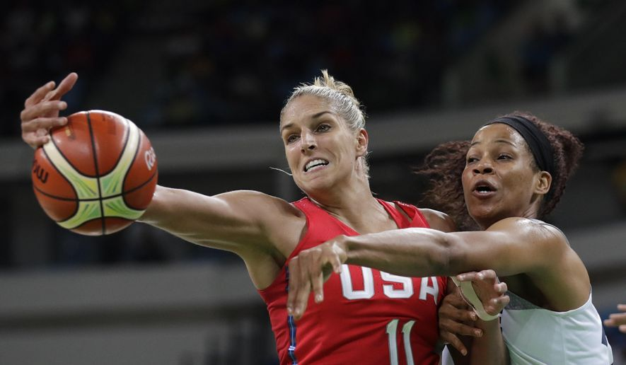 FILE - In this Thursday, Aug. 18, 2016 file photo, United States' Elena Delle Donne (11) and France's Marielle Amant, right, reach out for the ball during a women's semifinal round basketball game at the 2016 Summer Olympics in Rio de Janeiro, Brazil. (AP Photo/Eric Gay, File) **FILE**