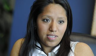 In this April 28, 2011, file photo, Jessica Colotl, an illegal immigrant and student at Kennesaw State University, speaks during a media interview at her lawyer's office in Atlanta. (AP Photo/John Amis, file)