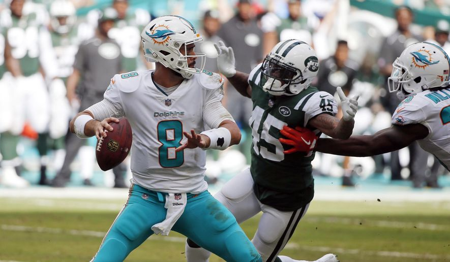 FILE - In this Sunday, Oct. 22, 2017, file photo, New York Jets free safety Rontez Miles (45) goes after Miami Dolphins quarterback Matt Moore (8), during the second half of an NFL football game in Miami Gardens, Fla. Moore makes his first start of the season Thursday night against the Baltimore Ravens. He takes over for injured Jay Cutler, who is sidelined with cracked ribs. (AP Photo/Wilfredo Lee, File)