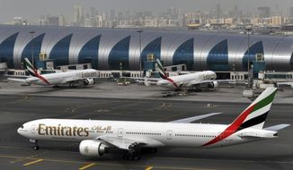 """FILE - In this Wednesday, March 22, 2017 file photo, an Emirates plane taxis to a gate at Dubai International Airport at Dubai International Airport in Dubai, United Arab Emirates. Long-haul carrier Emirates says it is starting new screening procedures for U.S.-bound passengers following it receiving """"new security guidelines"""" from American authorities. (AP Photo/Adam Schreck, File)"""