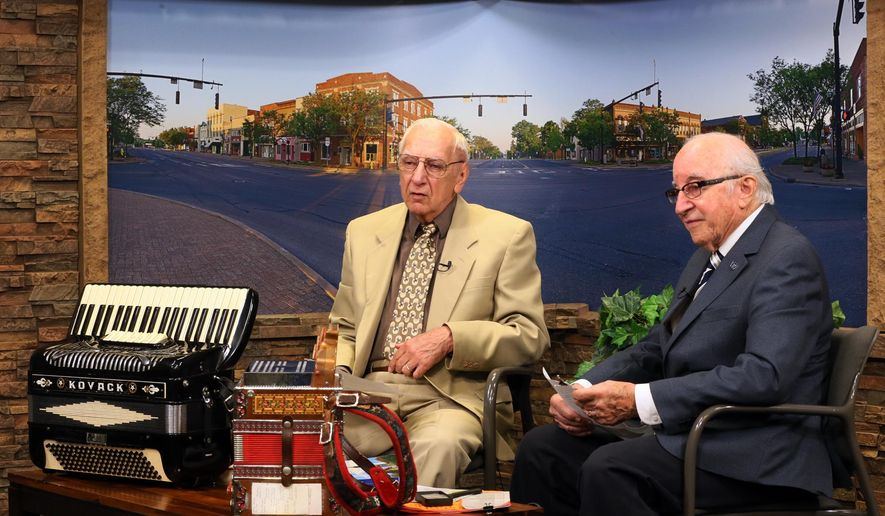 In this Sept. 19, 2017, photo, Gene Kovac, left, and Joe Gabrosek, hosts of Polka Time Again on WCTV, introduce a polka video during the taping of their show in Wadsworth, Ohio. (Mike Cardew/Akron Beacon Journal via AP)
