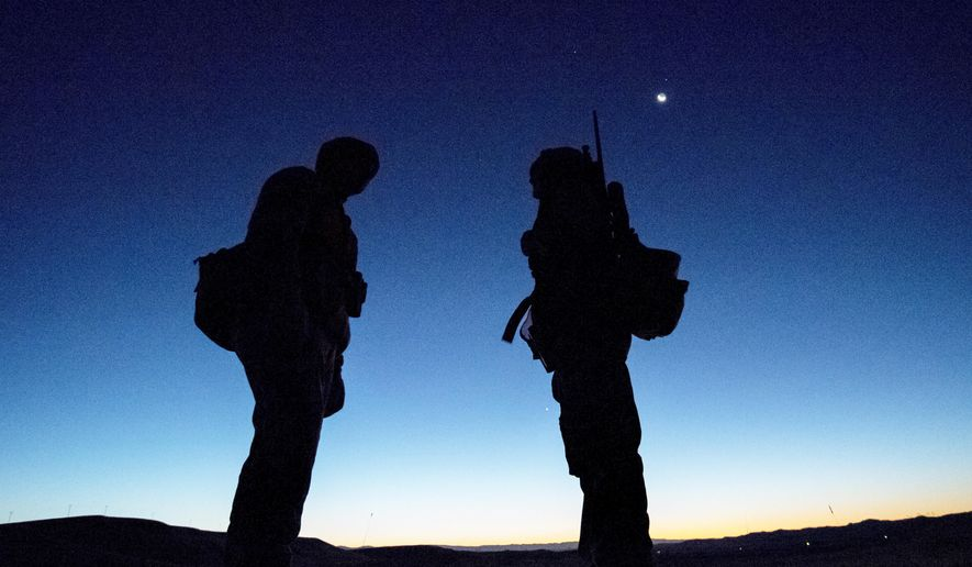 In a Oct. 15, 2017 photo, Frank Fagan, of Powell, Wyo., talks over the hunt plan before sunrise with his 12 year-old daughter, Shelby, before she pulled the trigger on her first deer during the opening day of deer season in Park County, Wyoming, on public access land near Heart Mountain Female hunters have increased in Wyoming by more than 30 percent since 2008.  (Mark Davis/The Powell Tribune via AP)