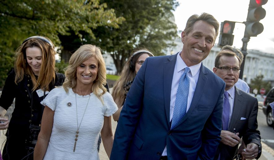 Sen. Jeff Flake, R-Ariz., accompanied by his wife Cheryl, leaves the Capitol in Washington, Tuesday, Oct. 24, 2017, after announcing he won't seek re-election in 2018. (AP Photo/Andrew Harnik) (AP Photo/Andrew Harnik)