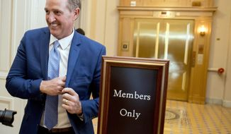 Sen. Jeff Flake, R-Ariz., walks on to the Senate floor on Capitol Hill in Washington, Tuesday, Oct. 24, 2017, after announcing he won't seek re-election in 2018. (AP Photo/Andrew Harnik)