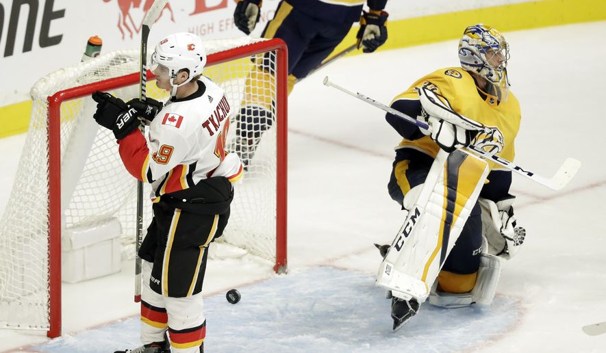 Calgary Flames left wing Matthew Tkachuk (19) celebrates after scoring a goal against Nashville Predators goalie Pekka Rinne (35), of Finland, in the third period of an NHL hockey game Tuesday, Oct. 24, 2017, in Nashville, Tenn. Tkachuk later scored the winning goal in a shootout as the Flames won 3-2. (AP Photo/Mark Humphrey)