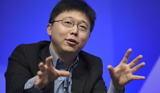 FILE - In this Dec. 1, 2015 file photo, Feng Zhang of the Broad Institute of MIT participates in a panel discussion at the National Academy of Sciences international summit on the safety and ethics of human gene editing, in Washington. Scientists are altering a powerful gene-editing technology in hopes of one day fighting diseases without making permanent changes to people's DNA.  (AP Photo/Susan Walsh)