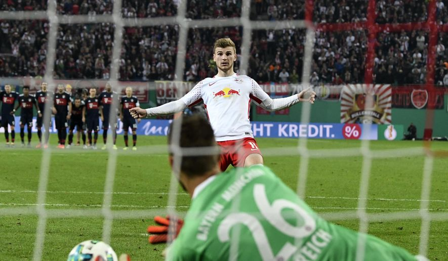 Leipzig's Timo Werner missing the last penalty against Bayern goalkeeper Sven Ulreich during the German soccer cup, DFB Pokal, match between the first divisioners RB Leipzig and FC Bayern Munich in Leipzig, Germany, Wednesday, Oct. 25, 2017. Bayern won by 6-5 after penalties. (AP Photo/Jens Meyer)