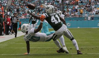 New York Jets cornerback Buster Skrine (41) defends Miami Dolphins wide receiver Kenny Stills (10), during the first half of an NFL football game, Sunday, Oct. 22, 2017, in Miami Gardens, Fla. The play at first was called as incomplete, the Dolphins challenged the ruling at it was reversed. (AP Photo/Lynne Sladky)