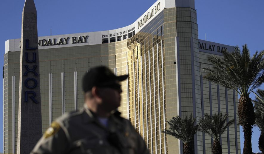 FILE - In this Oct. 3, 2017, file photo, a Las Vegas police officer stands by a blocked off area near the Mandalay Bay casino in Las Vegas. Amid pledges of $1 million from the federal government and $600,000 from the state to defray police and emergency response expenses following the Oct. 1 Las Vegas Strip shooting, officials are projecting the cost of the massacre, in dollars, at about $4 million. Las Vegas police on Wednesday, Oct. 25, 2017, gave what a department spokeswoman called a preliminary figure of $3.5 million for costs associated with the worst mass shooting in modern U.S. history. (AP Photo/John Locher, File)