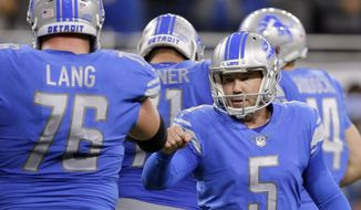 FILE - In this Sept. 10, 2017, file photo, Detroit Lions kicker Matt Prater (5) receives a fist bump from offensive guard T.J. Lang (76) after kicking a field goal against the Arizona Cardinals during an NFL football game in Detroit. Prater is under contract with the Lions through the 2020 season. The standout kicker signed a three-year extension Wednesday, OCt. 25, 2017. (AP Photo/Duane Burleson, File)
