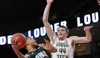 FILE - In this Nov. 18, 2016, file photo, Ohio guard Jaaron Simmons (2) drives against Georgia Tech center Ben Lammers (44) in the second half of an NCAA college basketball game in Atlanta. After losing Derrick Walton, Zak Irvin and D.J. Wilson, Michigan's success this season may depend on the performance of transfers Charles Matthews and Jaaron Simmons. (AP Photo/John Bazemore, File)