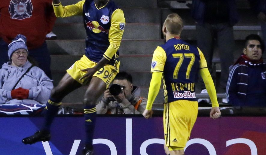 New York Red Bulls forward Bradley Wright-Phillips, left, celebrates with midfielder Daniel Royer after scoring his goal against the Chicago Fire during the first half of an MLS soccer playoff game, Wednesday, Oct. 25, 2017, in Bridgeview, Ill. (AP Photo/Nam Y. Huh)