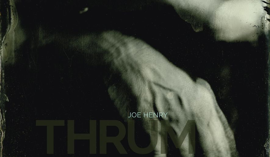 "This cover image released by earMUSIC shows ""Thrum,"" the latest release by Joe Henry. (earMUSIC via AP)"