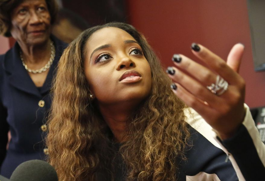 In this Oct. 17, 2017, photo, civil rights activist Tamika Mallory speaks at a news conference in New York. (AP Photo/Bebeto Matthews) **FILE**