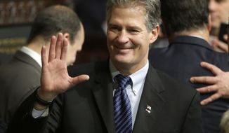 FILE - In this Jan. 8, 2015 file photo, former Massachusetts Sen. Scott Brown greets people on the floor of the House Chamber at the Statehouse in Boston.  U.S. Ambassador to New Zealand Brown told a New Zealand website Wednesday, Oct. 25, 2017, he accepted advice that he should be more culturally aware after a U.S. inquiry into his conduct at a Peace Corps event in Samoa. The Stuff news outlet says Brown acknowledged complaints were made about his comments to a female food server at the event and to guests upon his arrival in the Pacific country in July. (AP Photo/Steven Senne, File)