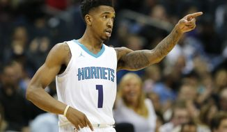 Charlotte Hornets guard Malik Monk motions to a teammate after a play against the Denver Nuggets during the second half of an NBA basketball game, Wednesday, Oct. 25, 2017, in Charlotte, N.C. (AP Photo/Jason E. Miczek)