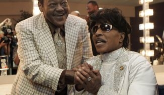 FILE - In this May 30, 2009 file photo, Fats Domino visits with Little Richard in a dressing room after Richards' performance at The Domino Effect, a tribute concert for Domino, at the New Orleans Arena in New Orleans.  Domino, the amiable rock 'n' roll pioneer whose steady, pounding piano and easy baritone helped change popular music even as it honored the grand, good-humored tradition of the Crescent City, has died. He was 89. Mark Bone, chief investigator with the Jefferson Parish, Louisiana, coroner's office, said Domino died Tuesday, Oct. 24, 2017.  (AP Photo/Patrick Semansky, File)