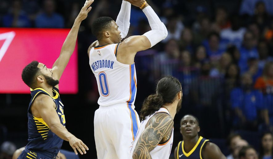 Oklahoma City Thunder guard Russell Westbrook (0) shoots between Indiana Pacers guard Cory Joseph, left, and guard Darren Collison, right, in the second quarter of an NBA basketball game in Oklahoma City, Wednesday, Oct. 25, 2017. (AP Photo/Sue Ogrocki)