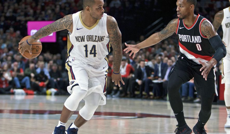 New Orleans Pelicans guard Jameer Nelson, left, passes the ball away from Portland Trail Blazers guard Damian Lillard, right, during the first half of an NBA basketball game in Portland, Ore., Tuesday, Oct. 24, 2017. (AP Photo/Craig Mitchelldyer)