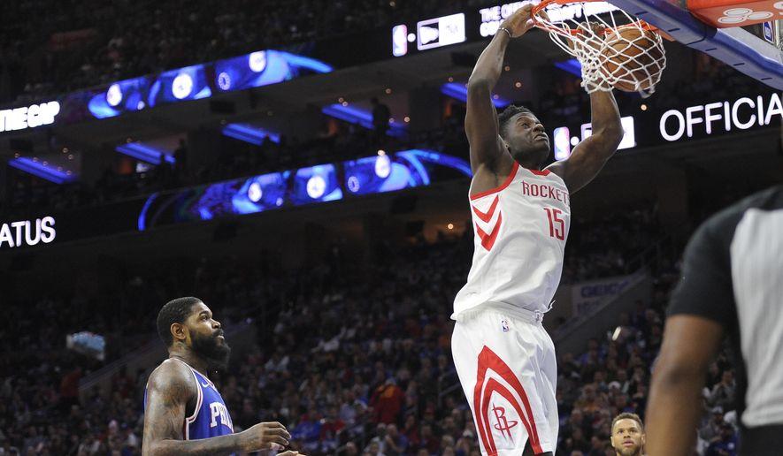 Houston Rockets' Clint Capela (15) dunks the ball over Philadelphia 76ers' Amir Johnson in the first half of an NBA basketball game, Wednesday, Oct. 25, 2017, in Philadelphia. (AP Photo/Michael Perez)