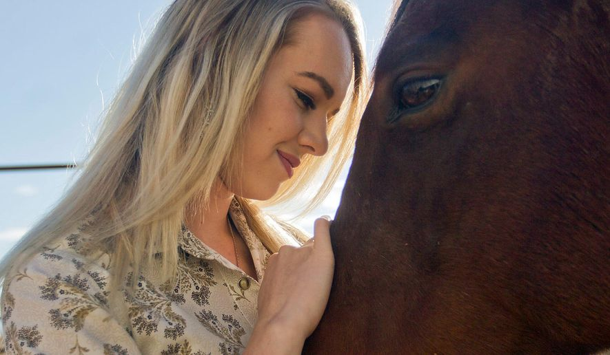 In this Oct. 20, 2017 photo, Miss Rodeo Wyoming 2018 Morgan Wallace shares a moment with her horse, Cookie Monster at the Spur Ridge Equestrian Center in Laramie, Wyo. (Shannon Broderick/Laramie Daily Boomerang via AP)