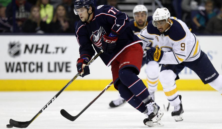 Columbus Blue Jackets forward Josh Anderson, left, controls the puck against Buffalo Sabres forward Evander Kane during the second period of an NHL hockey game in Columbus, Ohio, Wednesday, Oct. 25, 2017. The Blue Jackets won 5-1. (AP Photo/Paul Vernon)