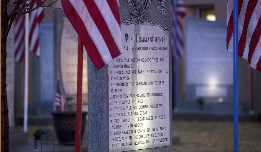 The Bloomfield Ten Commandments memorial is pictured, Monday, Feb. 13, 2017 at Bloomfield City Hall in Bloomfoeld,, N.M The U.S. Supreme Court on Monday, Oct. 16, 2017, sided with a lower court, the the 10th U.S. Circuit Court of Appeals, that ordered Bloomfield to remove a Ten Commandments monument from the lawn outside City Hall. (Jon Austria/The Daily Times via AP)