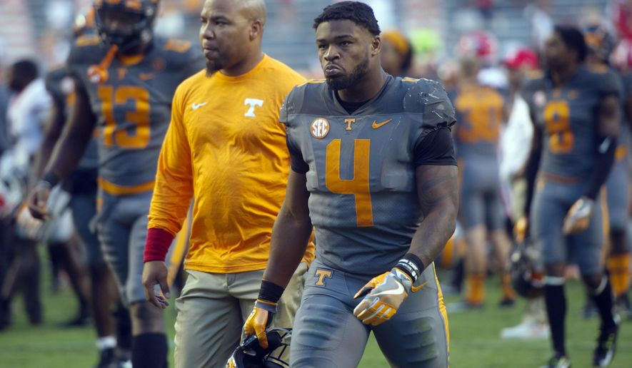 FILE - In this Sept. 30, 2017, file photo, Tennessee running back John Kelly (4) walks off the field after their 41-0 loss to Georgia in an NCAA college football game in Knoxville, Tenn. Kelly and linebacker Will Ignont have received citations after police said they found marijuana in Kelly's car during a traffic stop. Knoxville police say they stopped a car for having a headlight out Tuesday, Oct. 24, 2017, at about 10:46 p.m. Police said they searched the vehicle after smelling marijuana and found 4.6 grams of marijuana and a glass pipe in the console. (Caitie McMekin/Knoxville News Sentinel via AP, File)