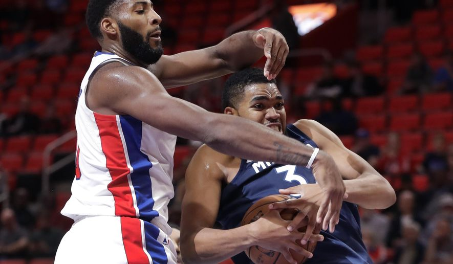 Minnesota Timberwolves forward Anthony Brown (3) grabs a rebound in front of Detroit Pistons center Andre Drummond (0) during the first half of an NBA basketball game, Wednesday, Oct. 25,2017, in Detroit. (AP Photo/Carlos Osorio)