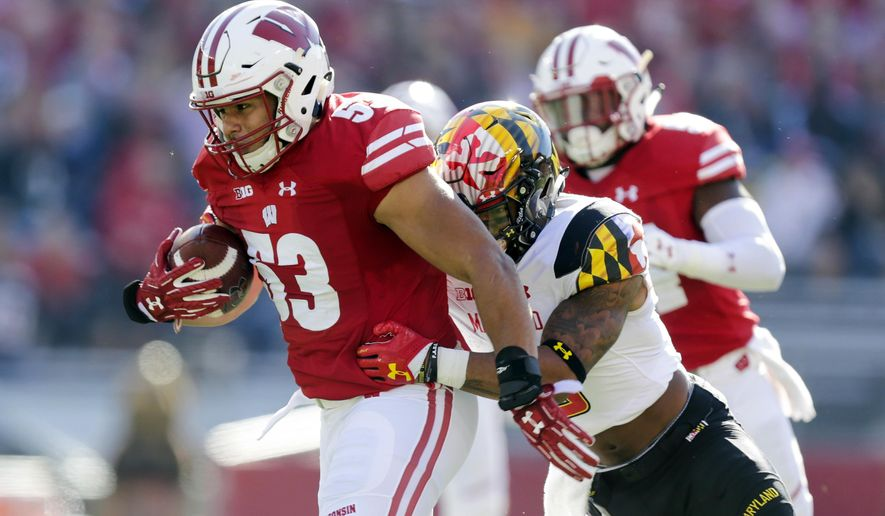 FILE - In this Saturday, Oct. 21, 2017, file photo, Wisconsin linebacker T.J. Edwards returns an interception for a touchdown against Maryland wide receiver Jahrvis Davenport during the first half of an NCAA college football game in Madison, Wis. Such a picky defense at No. 5 Wisconsin. Not only do the Badgers excel at getting interceptions, but they're a threat to score on defense too, tied with Duke for an FBS-leading four pick-6s this season. (AP Photo/Andy Manis)