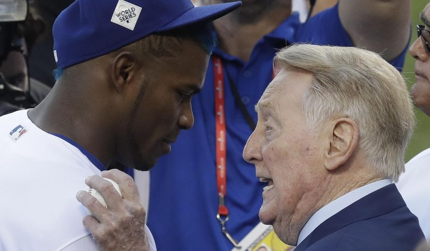 Vin Scully talks to Los Angeles Dodgers' Yasiel Puig before Game 2 of baseball's World Series against the Houston Astros Wednesday, Oct. 25, 2017, in Los Angeles. (AP Photo/Alex Gallardo)