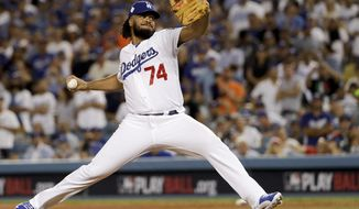 Los Angeles Dodgers relief pitcher Kenley Jansen throws against the Houston Astros during the eighth inning of Game 2 of baseball's World Series Wednesday, Oct. 25, 2017, in Los Angeles. (AP Photo/Matt Slocum)