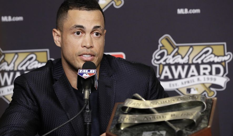 Miami Marlins' Giancarlo Stanton talks after winning the National League Hank Aaron Award at baseball's World Series Wednesday, Oct. 25, 2017, in Los Angeles. (AP Photo/Alex Gallardo)