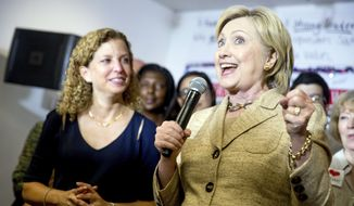 Democratic presidential candidate Hillary Clinton, right, stops in to speak to workers at a campaign office for Rep. Debbie Wasserman Schultz, D-Fla., left, in Davie, Fla., Tuesday, Aug. 9, 2016. (AP Photo/Andrew Harnik) ** FILE **