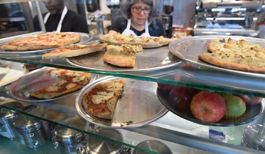 """Dudley Dough, a """"fair wage"""" pizza shop in Boston's Roxbury neighborhood that prided its commitment to economic justice, is closing its doors after only two years in business, citing financial struggles. (Facebook/@Dudley Dough)"""