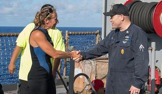 USS Ashland Command Master Chief Gary Wise greets Jennifer Appel, an American mariner who was lost in the Pacific Ocean for five months, Oct. 25, 2017. (Image: U.S. Navy photo by Mass Communication Specialist 3rd Class Jonathan Clay/Released)