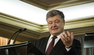 President of Ukraine, Petro Poroshenko speaks during a press conference with Prime Minister Justin Trudeau, in Toronto on Friday, Sept. 22, 2017. (Christopher Katsarov/The Canadian Press via AP)