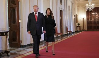 President Donald Trump and first lady Melania Trump walk in to speak on combatting drug demand and the opioid crisis in the East Room of the White House in Washington, Thursday, Oct. 26, 2017. (AP Photo/Pablo Martinez Monsivais)