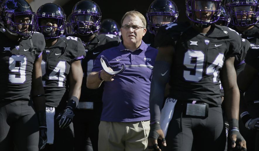 FILE - In this Oct. 1, 2016, file photo, TCU head coach Gary Patterson, center, stands with his players before an NCAA college football game against Oklahoma in Fort Worth, Texas. The Big 12 Conference has reached the midpoint of conference play with a tight race behind fourth-ranked TCU. While the Horned Frogs are the league's only undefeated team, there is a four-way tie for second place among Top 25 teams. (AP Photo/LM Otero, File)