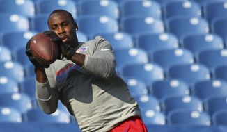 FILE - In this Thursday, Aug. 10, 2017 file photo, Buffalo Bills' Anquan Boldin warms up before a preseason NFL football game against the Minnesota Vikings in Orchard Park, N.Y. A person with direct knowledge of the decision has confirmed to The Associated Press that the Buffalo Bills have granted retired receiver Anquan Boldin permission to explore the possibility of being traded to another team. The person spoke on the condition of anonymity on Thursday, Oct. 26, 2017 because the Bills and Boldin have not revealed this information. (AP Photo/Jeffrey T. Barnes, File)