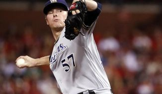 FILE - In this Sept. 29, 2017, file photo, Milwaukee Brewers starting pitcher Chase Anderson throws during the first inning of a baseball game against the St. Louis Cardinals in St. Louis. The Brewers have signed Anderson to a two-year contract through the 2019 season, with club options for 2020 and 2021. The 29-year-old right-hander was eligible for arbitration. (AP Photo/Jeff Roberson, File)